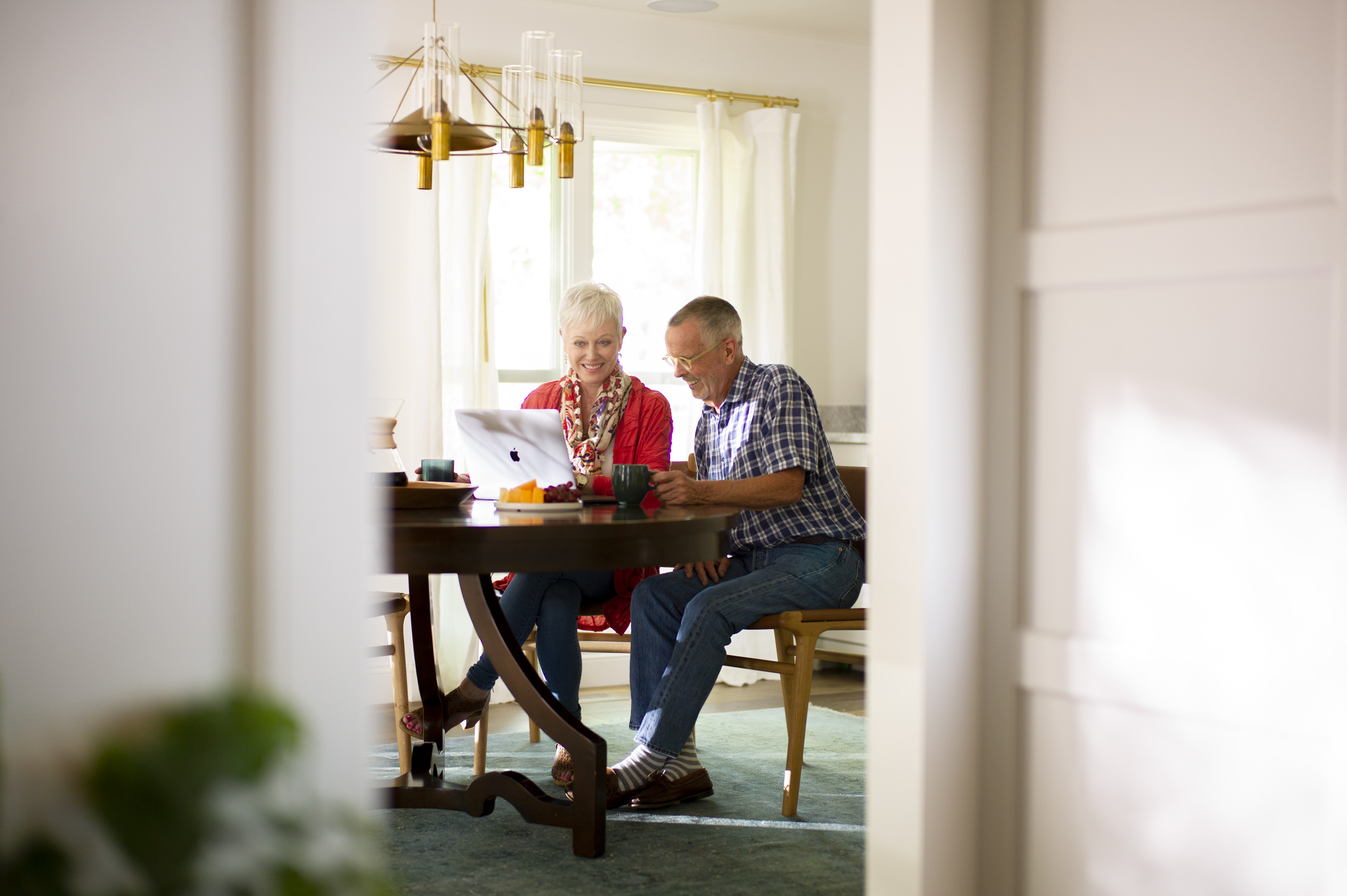 Couple looking at home listings online
