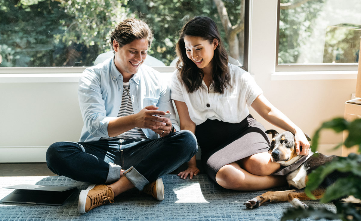 Couple looking at property listing on their phone