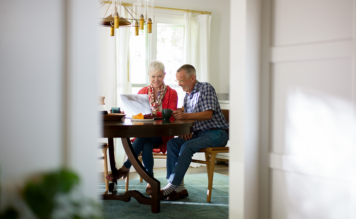 Couple looking at real estate resources online