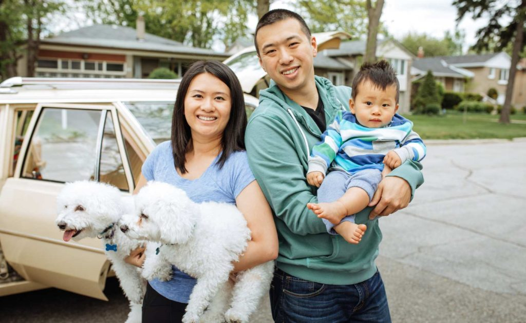 Young couple with a new baby and 2 dogs