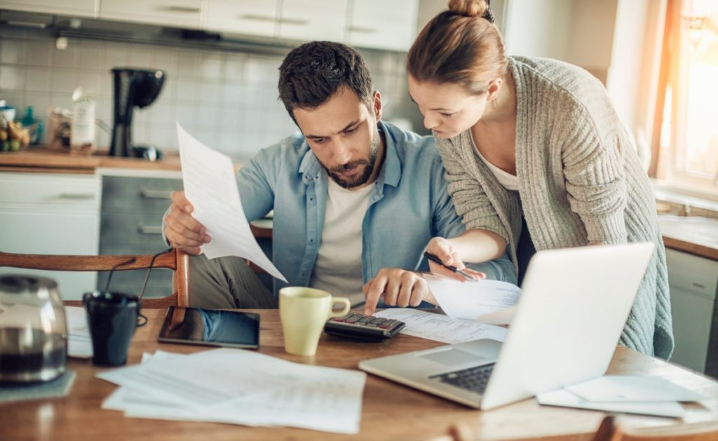 Couple looking at finances to see how much house they can afford